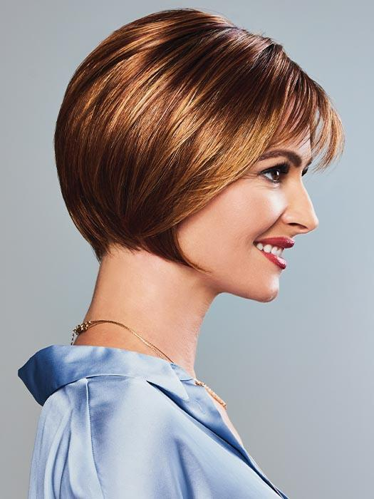 Chin length layers at the sides gracefully frame the face