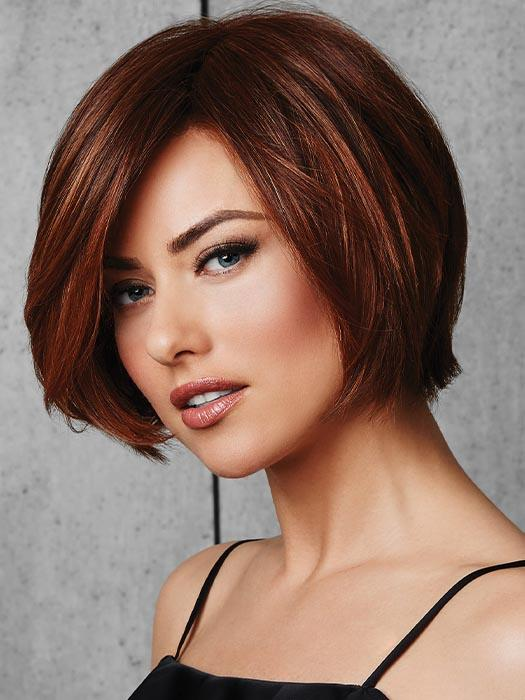 Long, side sweeping fringe and subtly layered, chin-length sides frame the face