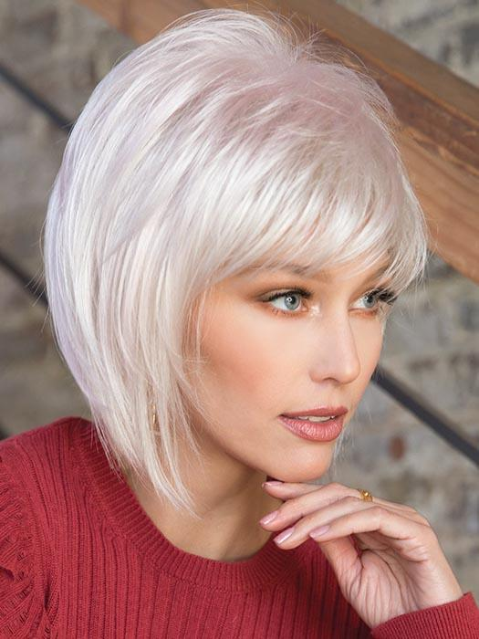 A short, jazzy bob with side swept fringe and textured layers