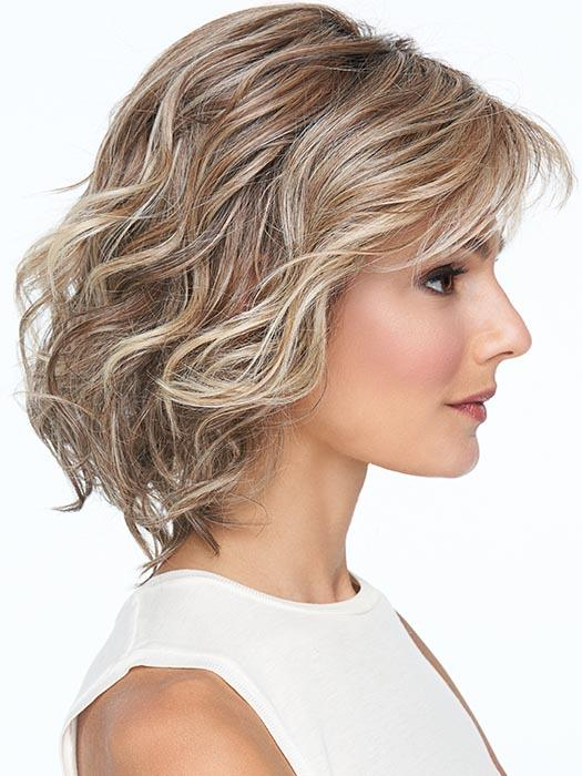 A gently waved and tousled layered bob that offers even more styling versatility with 100% hand-tied cap