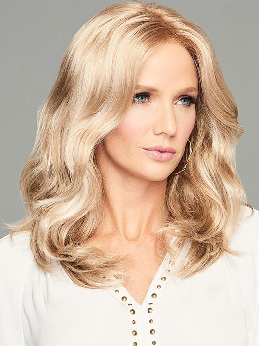 Luscious shoulder-length style features gentle waves that tumble loosely for loads of movement