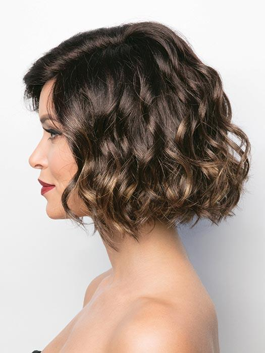 A short, flirty bob with a side swept fringe. With her tousled waves that give this style the perfect amount of volume to flatter any face shape