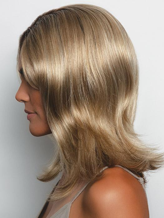 A long layered wavy style with a monofilament top that can be styled and adjusted to fit any mood