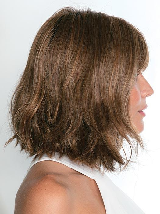The Alexi Wig by Noriko is a textured bob with bangs that frames the face perfectly creating a modern fit.