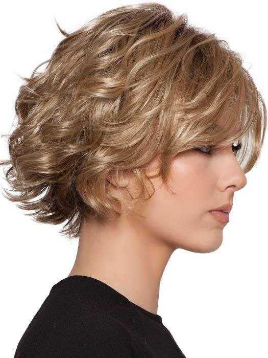 A short-layered style with soft curls and a long off-center bang