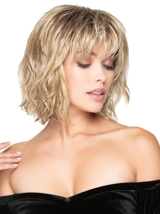 A long, mid-length layered bob with feathered bangs, a smooth silky top, and textured layers that fall below the collar