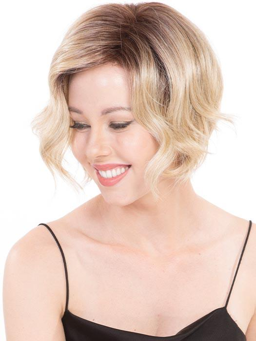 This A-line cut with modern, loose wavy layers, reminiscent of old Hollywood vibes, frames the face perfectly