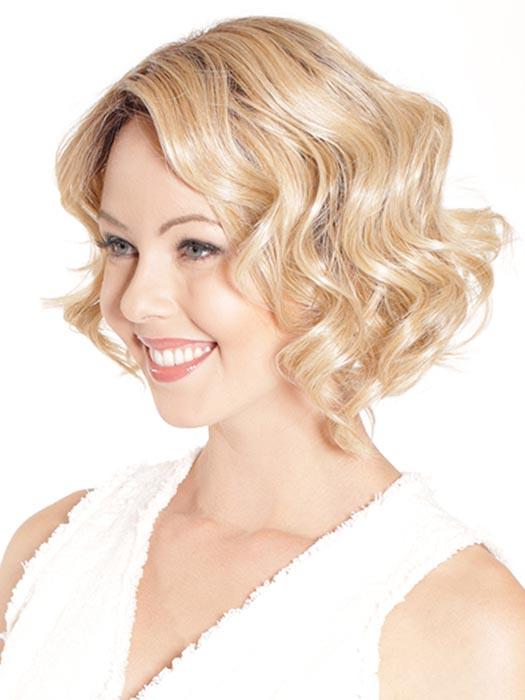 The ultimate in sexy, elegant, modern version of the star's look has large layers with fringe in the front and shorter layers in the back