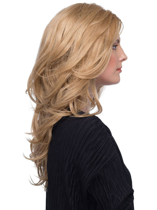 This below the shoulder style with long layers and loose waves is gorgeous. You can enjoy the freedom to style in any direction
