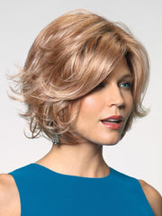Dolce by Noriko is a chin-length, layered, and voluminous synthetic wig
