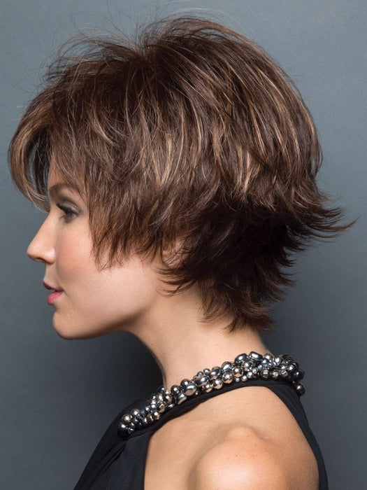 Face framing fringe, that is flattering and the tousled layering throughout adds a fun, fresh look