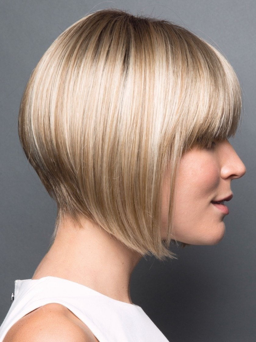 Look like you've just stepped out of the salon with this sleek angled cut that features bold, blunt bangs and a tapered back.