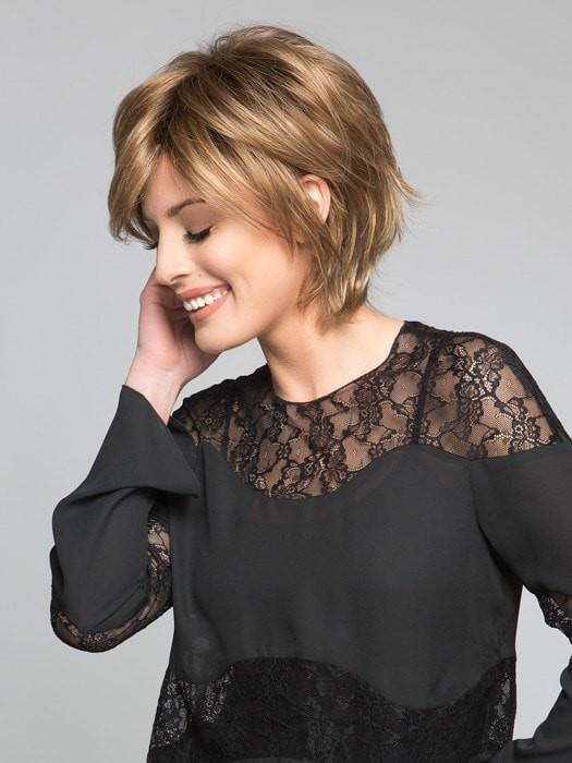A face flattering bob wig with feathered layers and wispy ends