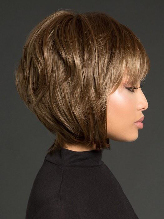 It has shaggy layers in the back, longer pieces in the front and a wispy bang