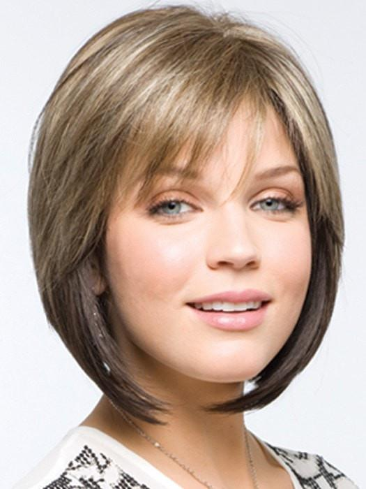 A swingy chin length angled bob with side swept fringe creates a simply beautiful look