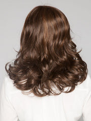 Lovely layers all over create cascading curls | Color: Toasted Brown