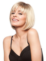 This chin length bob with wispy bangs perfectly frames the face