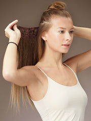 Section your hair from side to side and clip the weft close to your root