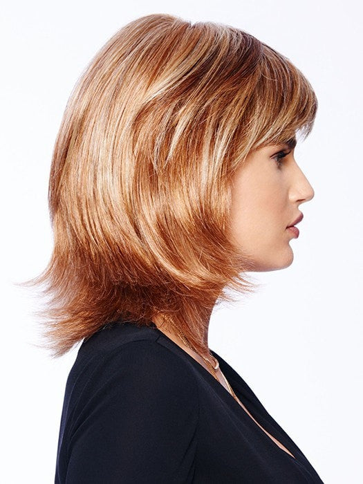 This style has razor tapered bangs that blend into long, razor-cut layers in the sides and back