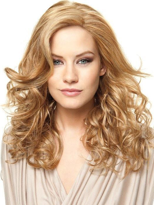 Heat-Friendly synthetic fiber, styled curly in this photo. Shown in RL14/25 HONEY GINGER | Dark Blonde Evenly Blended with Medium Golden Blonde