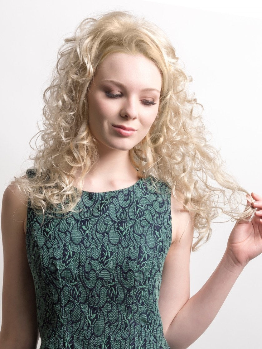 Anemone by Wig Pro is a ¾ fall that, worn with your own hair, creates a cascade of beautiful, romantic locks. This piece attaches with a teeth comb on the top and bottom.