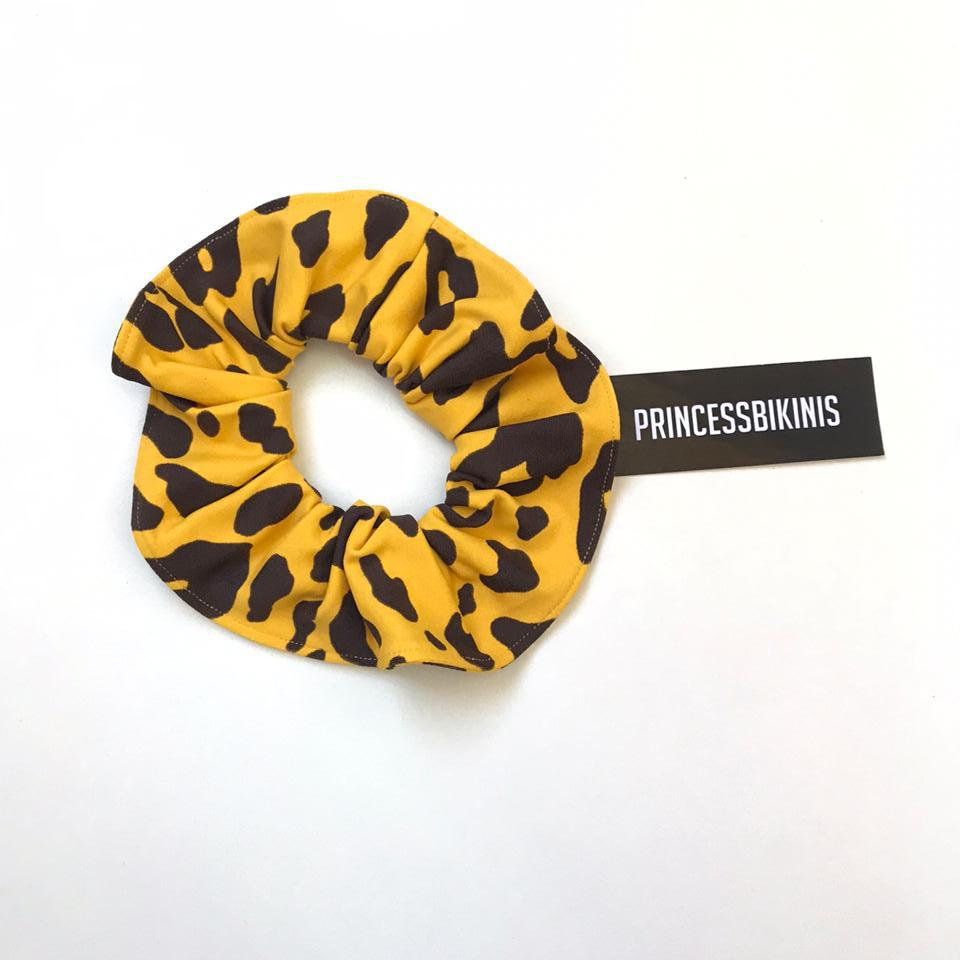 COLETERO ANIMAL PRINT AMARILLO