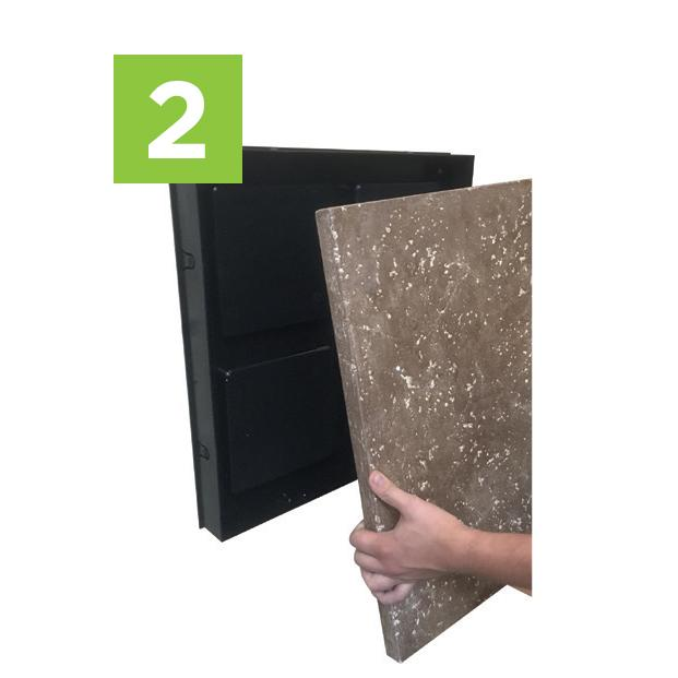 Step Two to install your moss wall art kit -  Insert panel into wall frame.
