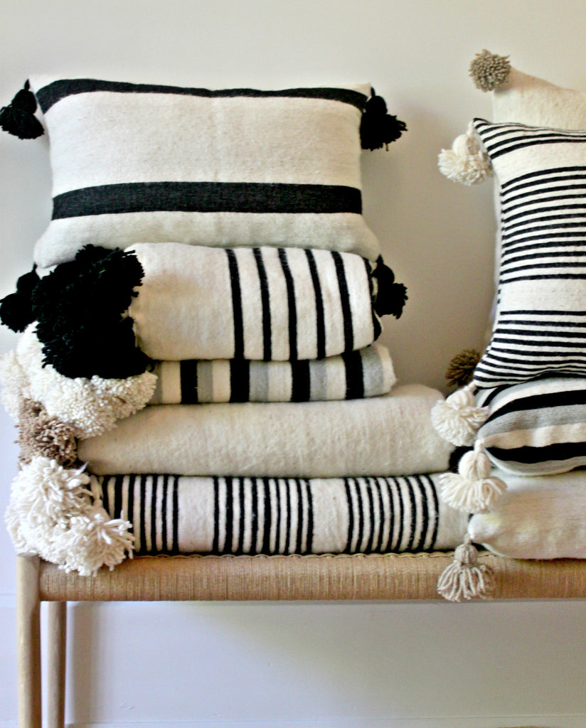 cushion rectangle black stripe pom pom