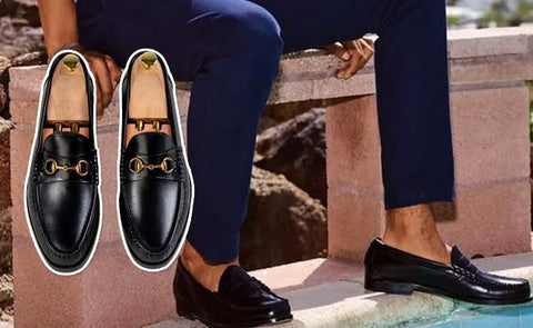 black horsebit penny loafer with blue pants
