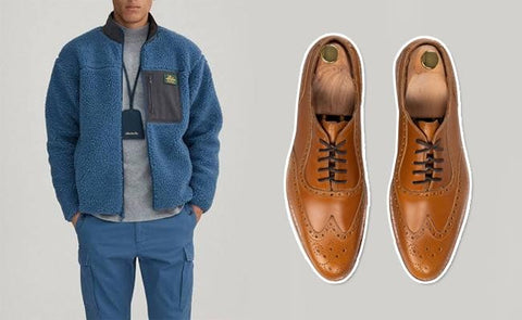 cognac tan brown oxford wingtips with jean jacket and blue cargo pants