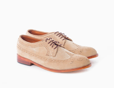 The classic Men's dress shoe in sand suede. A modern take on the longwing oxford.