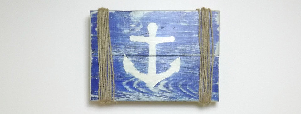 Rustic blue sign with white anchor & rope on sides