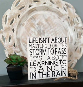 Life Isn't About Waiting For The Storm To Pass Wooden Block Sign