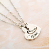 "2 heart pendants engraved ""Mother Daughter"""