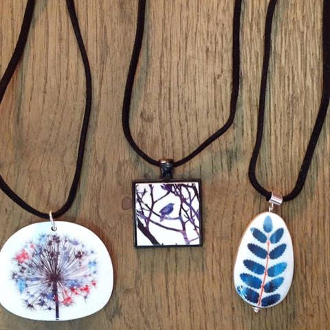 These lovely necklaces are made by the  talented Art You Wear, Justine Nettleton. Our customers have fallen in love with them! Could you resist?
