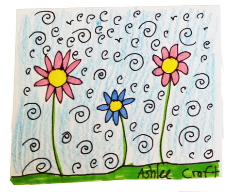 Handmade sticker with three flowers under a sky of whimsical swirls