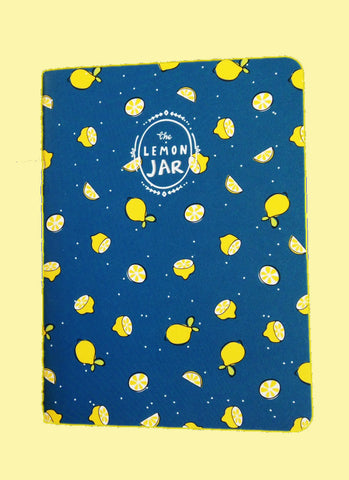Blue notebook covered with lemon print