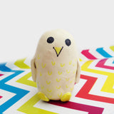 Yellow and cream whimsical owl figurine