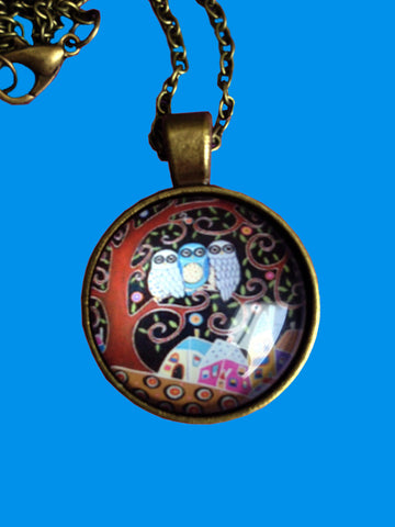 Round necklace with owls in a tree over a house