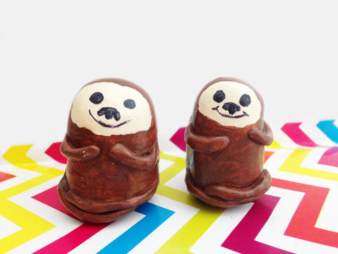 Two cute handmade sea otter figurines