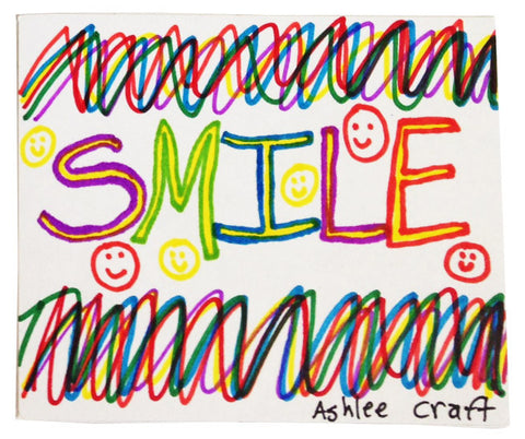 "Handmade sticker with zigzags of color, the word ""SMILE"", and six tiny colorful smiley faces"