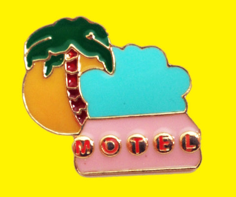 Tropical motel enamel pin with a vintage motel sign & palm tree.