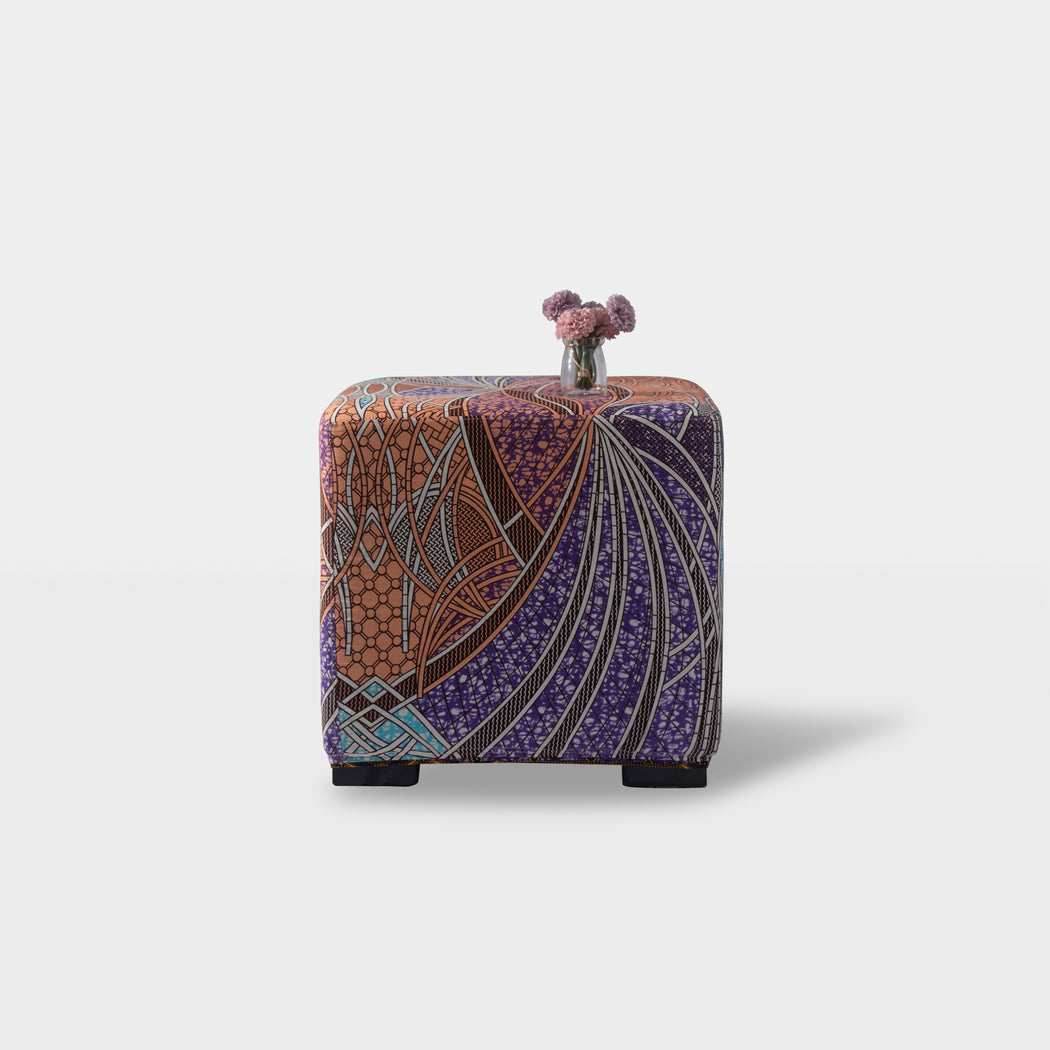 Front view of - Salmon pink with purple and blue patterned print square ottoman pouf
