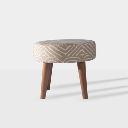Sun tanned circle coffee table with tribal prints and beechwood legs