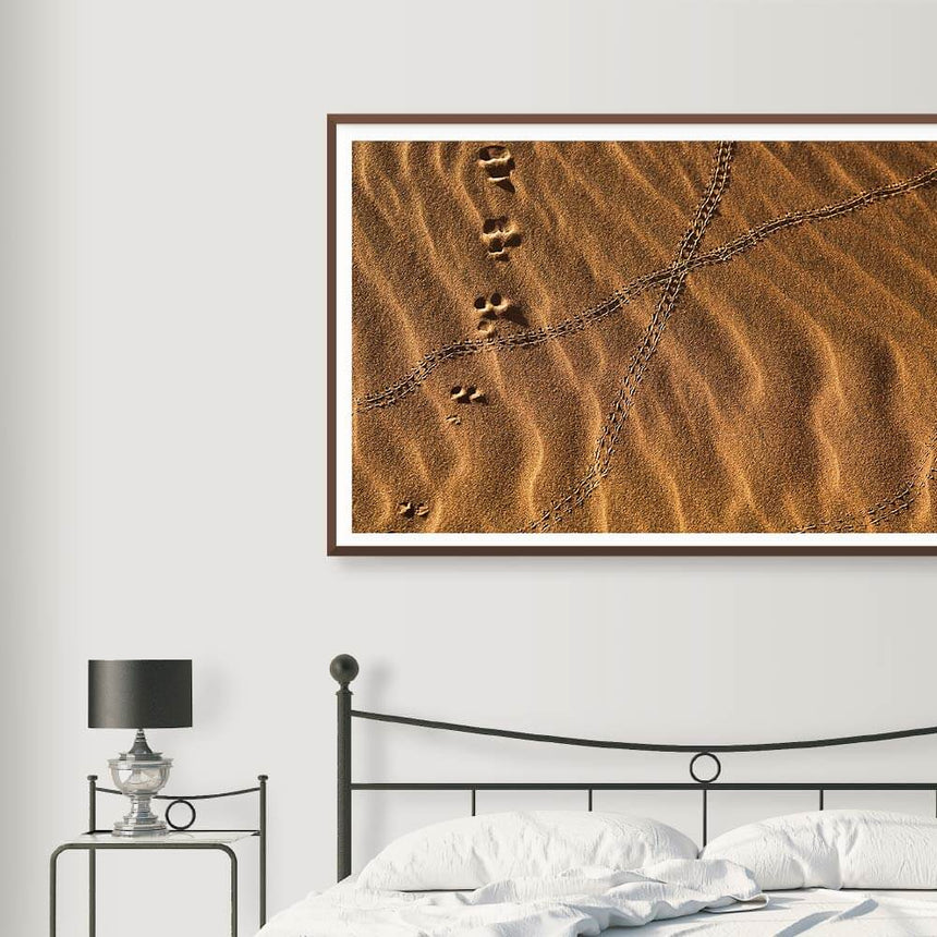 Fine art photographic print by Jonathan and Angela Scott, depicting footprints in the sand in Sossusvlei, Namibia.