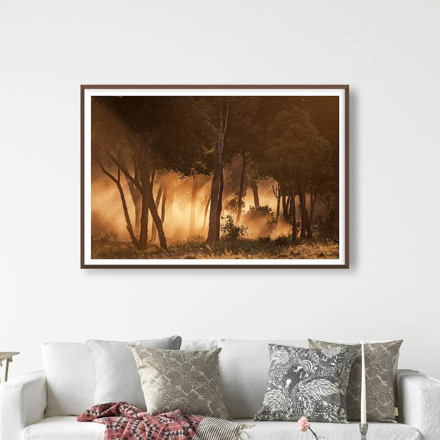 Fine art photographic print by Jonathan and Angela Scott, depicting dust and backlight at sunset in Maasai Mara, Kenya.