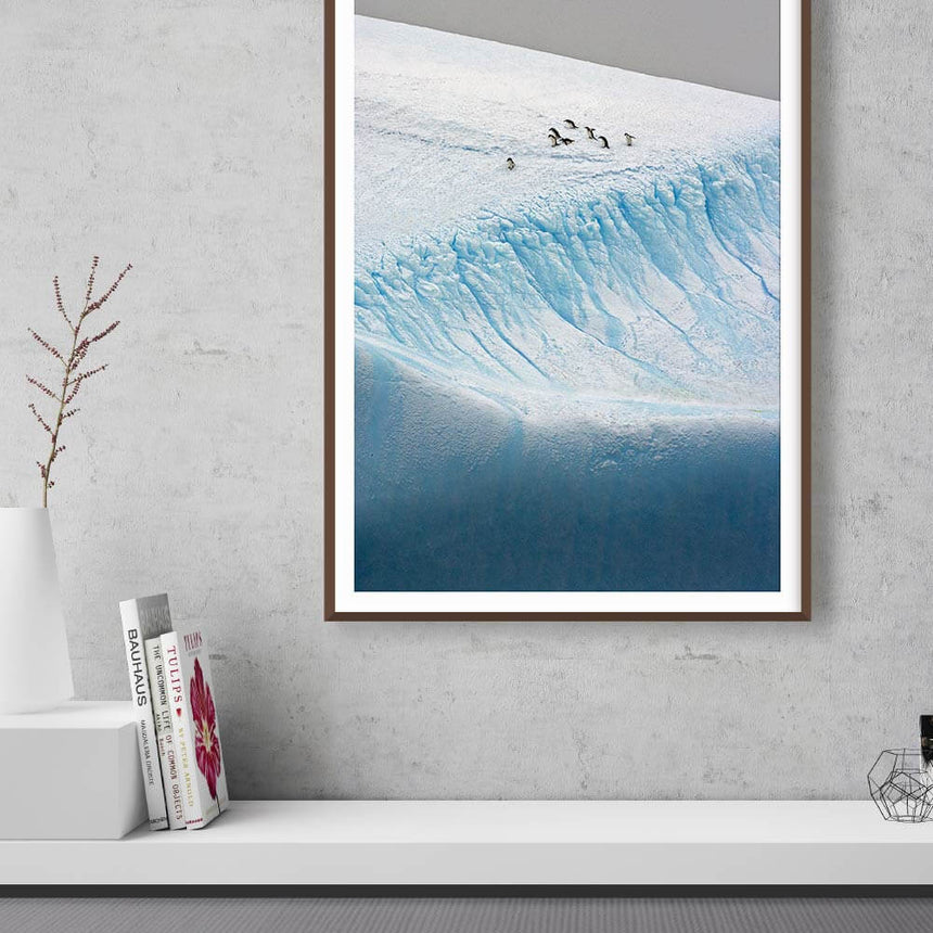 Fine art photographic print by Jonathan and Angela Scott, depicting a colony of emperor penguins on ice in Antarctica.