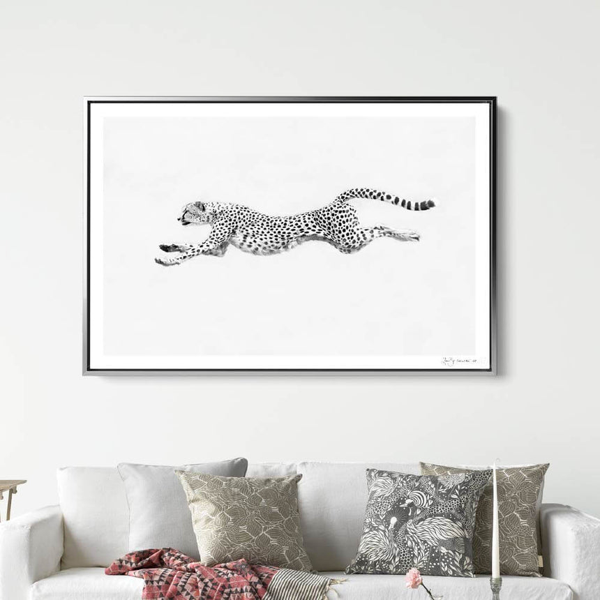 Limited edition photographic print by Jonathan and Angela Scott, depicting a female cheetah in flight in Maasai Mara, Kenya.