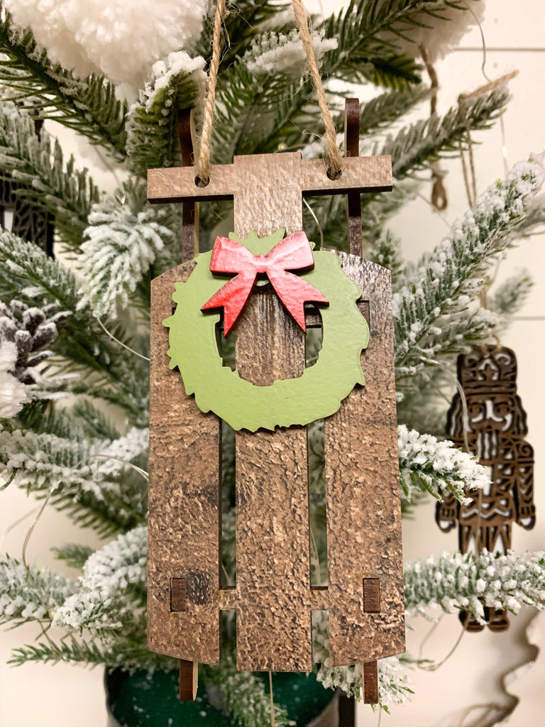 Wooden sled ornament with wreath