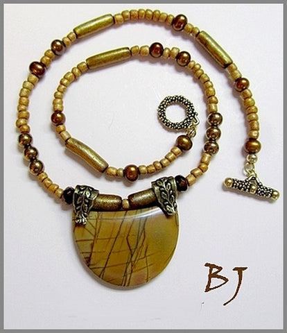 An Interesting Picasso Jasper Pendant with Golden Accents-Adornments by BJ